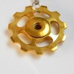 gold Jockey wheel key ring