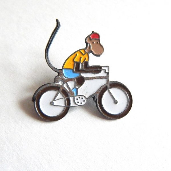 Vintage Monkey on a bike badge