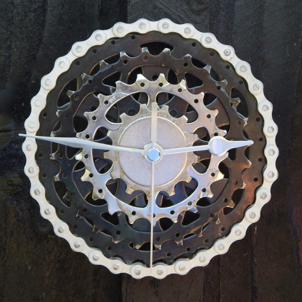Wall clcok made using bicycle cassette sprockets with bicycle chain around the outside, black with silver hands