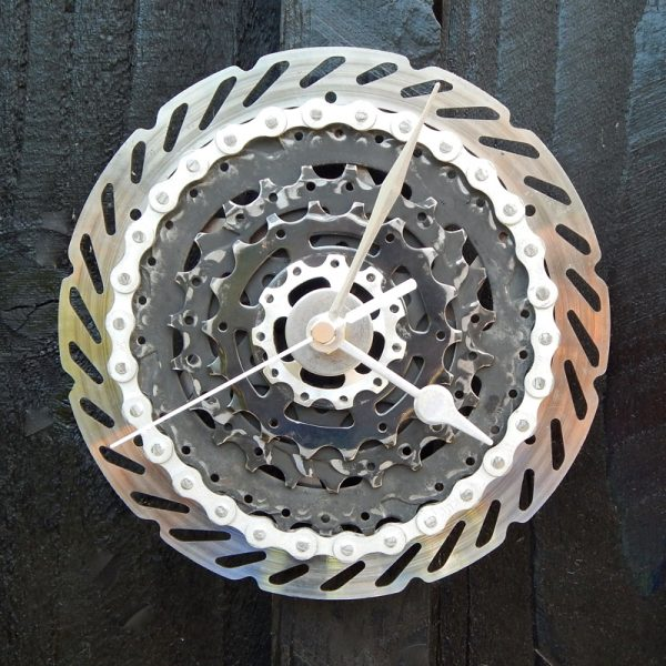 upcycled bicycle brake rotor and bicycle cassette parts wall clock, black and silver with silver hands and silver chain